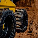 bobcat tires working in gravel
