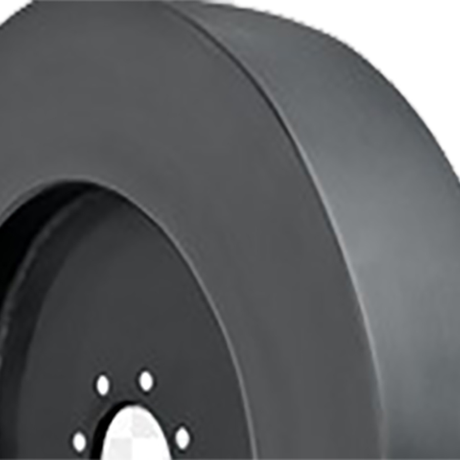 Smooth solid skid steer tire