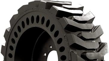 elongated apeture hole solid skid steer tires