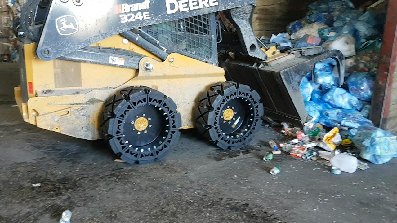 hard surface skid steer tire in waste transfer station