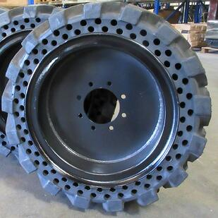 staggered aperture hole solid skid steer tire
